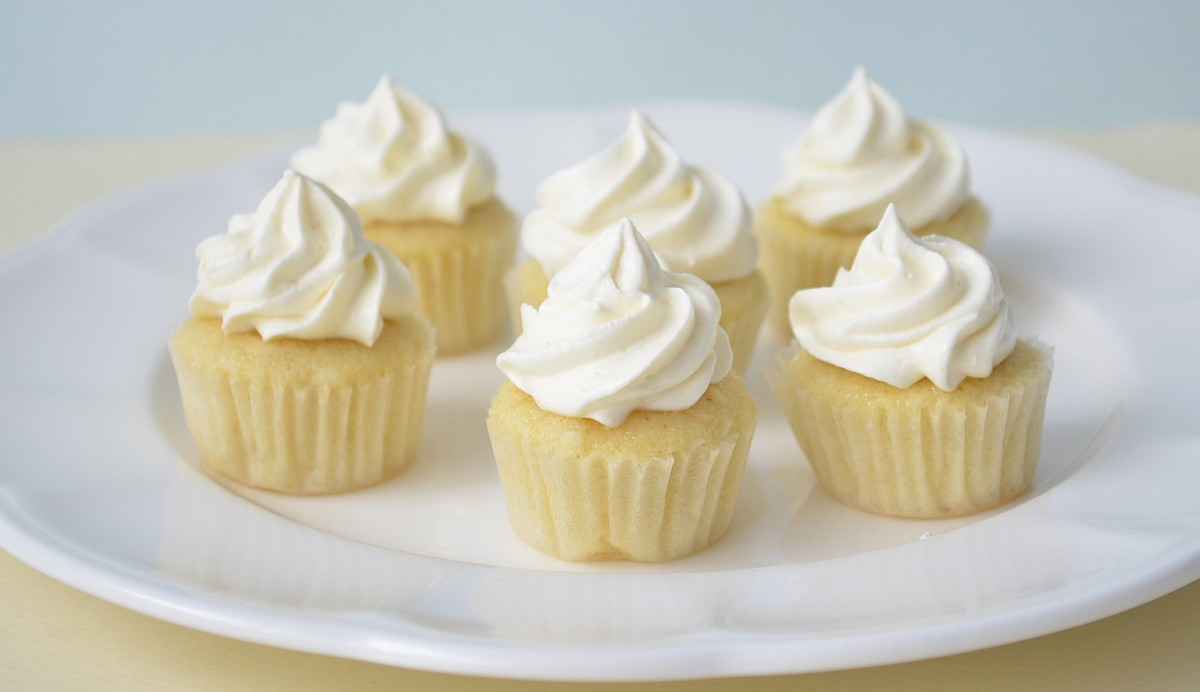 Made with grated coconut and coconut milk, these cupcakes are full of ...